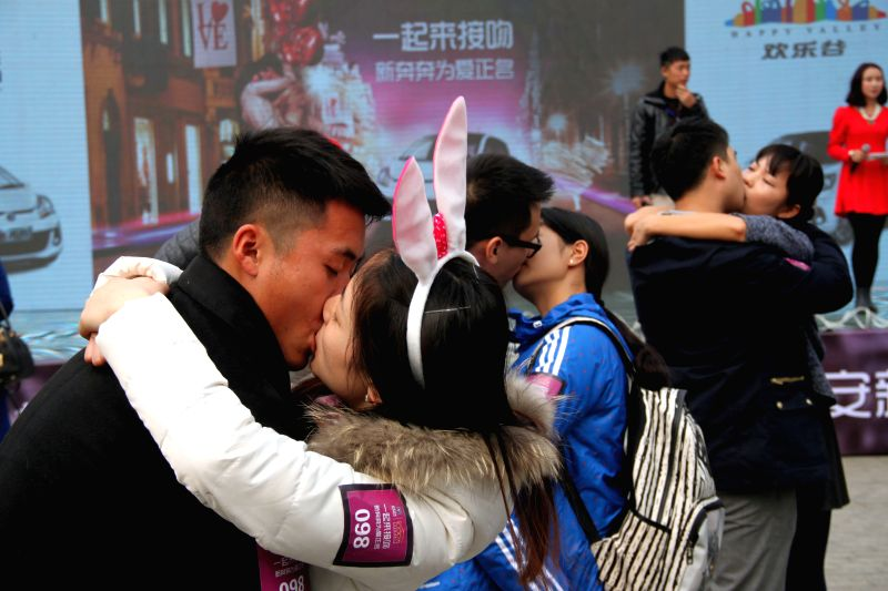 Couples kiss during a kiss contest in Chengdu, capital of southwest China's Sichuan Province, Feb. 14, 2015, the Valentine's Day.