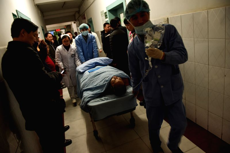 An injured person receives treatment in hospital after a blast in a road tunnel under construction in Chengdu, capital of southwest China's Sichuan Province, Feb. ...