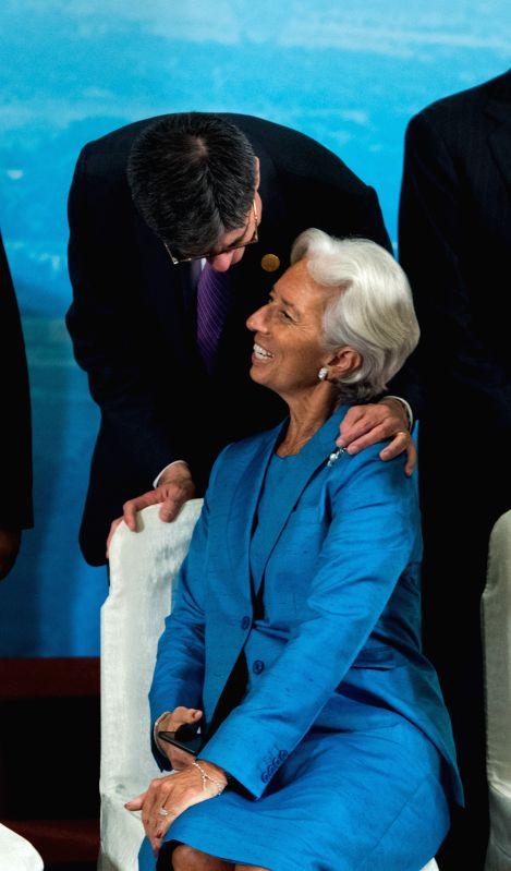 CHENGDU, July 24, 2016 - U.S. Treasury Secretary Jacob Lew (back) talks with International Monetary Fund (IMF) managing-director Christine Lagarde before a group photo during a meeting of G20 finance ... - Christine Lagarde