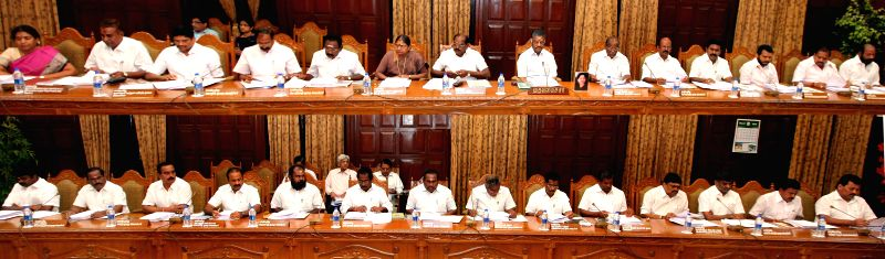 (A combo photo) Tamil Nadu Chief Minister O. Panneerselvam during a cabinet meeting in Chennai on Feb 6, 2015. - O. Panneerselvam