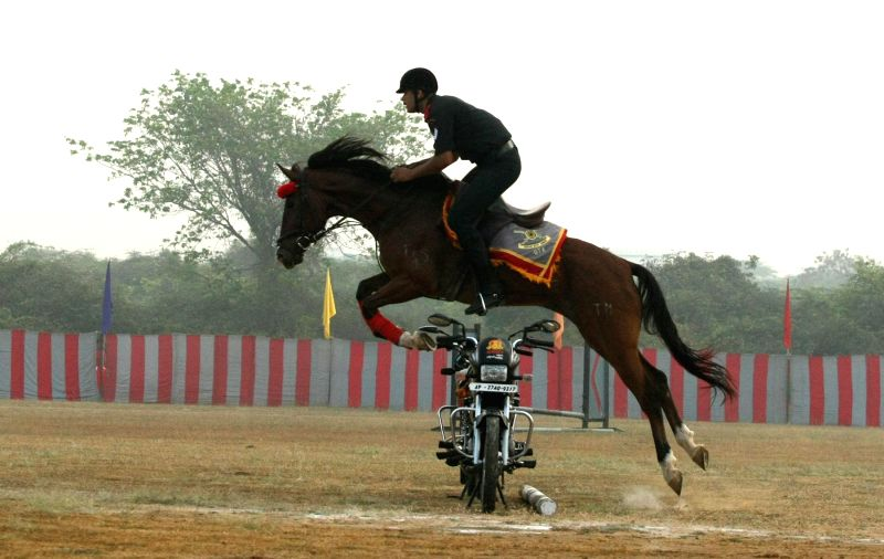 A soldier displays his skills during the Combined display - a prelude to the Passing Out Parade - organised at Officers Training Academy (OTA), in Chennai on March 13, 2015.