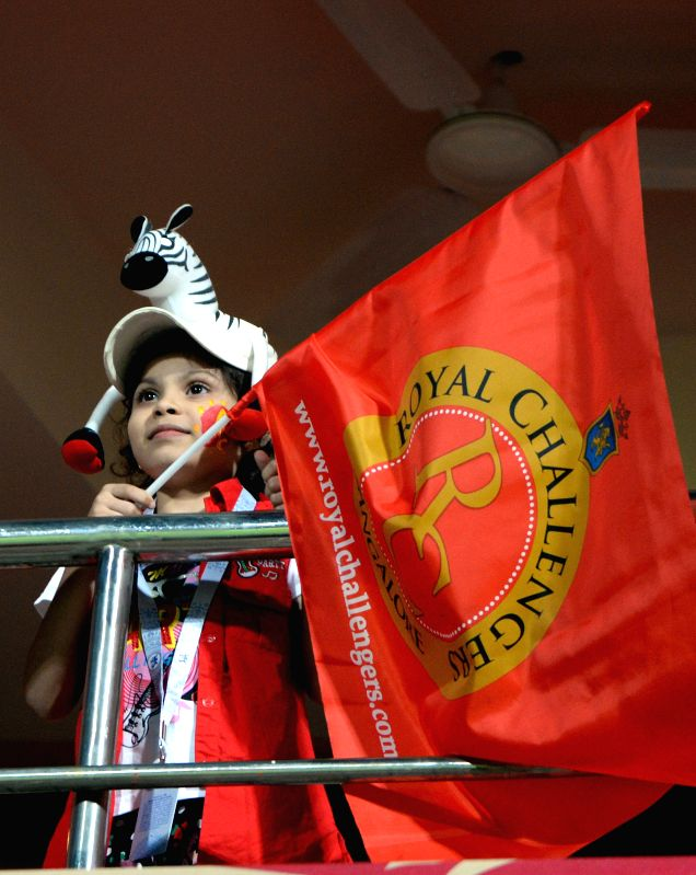 A young cricket fan during an IPL-2015 match between Royal Challengers Bangalore and Sunrisers Hyderabad at M Chinnaswamy Stadium, in Bengaluru, on April 13, 2015.