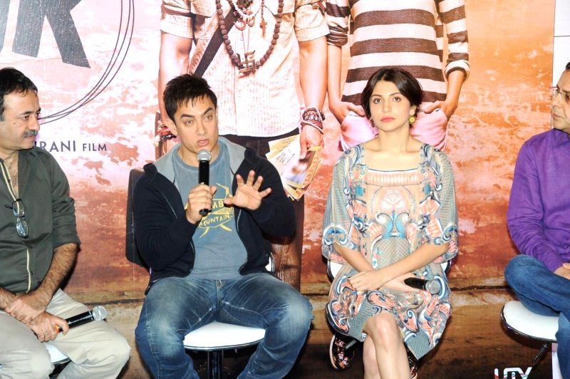 Actors Aamir Khan and Anushka Sharma during their upcoming film PK  press meet in Chennai  on Dec 10, 2014.