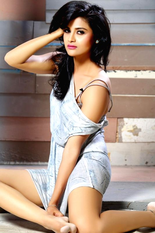 Actress Devyani poses during a photoshoot.