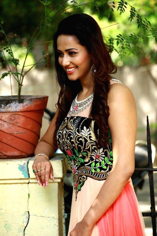 Actress Sanjana Singh poses for a photograph during a photoshoot.