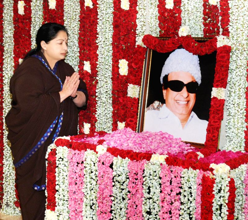 AIADMK supremo J Jayalalithaa paying tribute to party founder the late M G Ramachandran on his 95th birth anniversary, at her residence in Chennai on Jan. 17, 2014. (Photo : IANS)