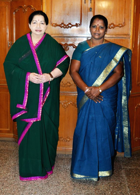AIADMK supremo J Jayalalithaa with S. Valarmathi - party's candidate to contest by-elections for Srirangam assembly constituency, that  fell vacant after the conviction of  Jayalalithaa in a