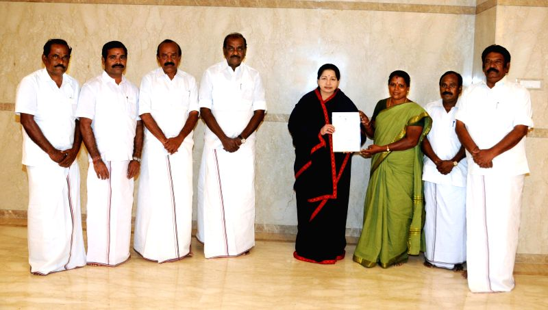 AIADMK supremo Jayalalithaa and other senior party leaders congrats S. Valarmathi after her win over the Srirangam seat by-poll, at her Poes Garden residence in Chennai  on Feb 16, 2015. The