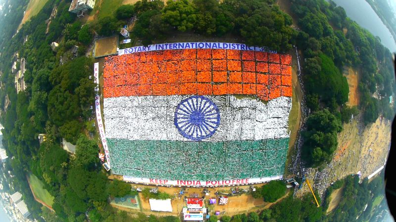An aerial view of volunteers standing in the formation of tricolour at Nandanam YMCA Ground in Chennai on Dec 7, 2014. The volunteers created a New Guinness World Record for the largest ...
