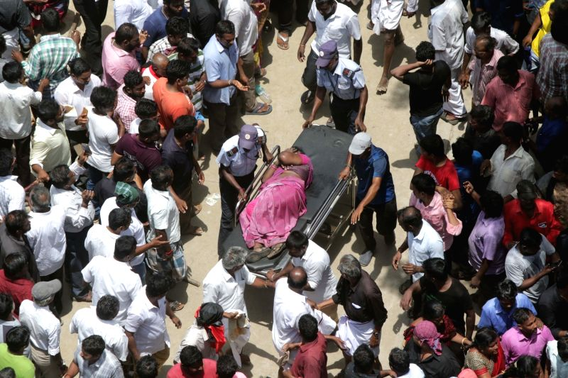 : Chennai: An injured being taken for treatment after a stampede broke out at Rajaji Hall, where the 94-year-old DMK patriarch and former Tamil Nadu Chief Minister M. Karunanidhi's body lays in ...