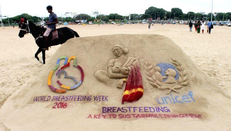 Chennai arts students' sand sculpture at Marina Beach during World Breastfeeding Week 2016 on Aug 3, 2016.