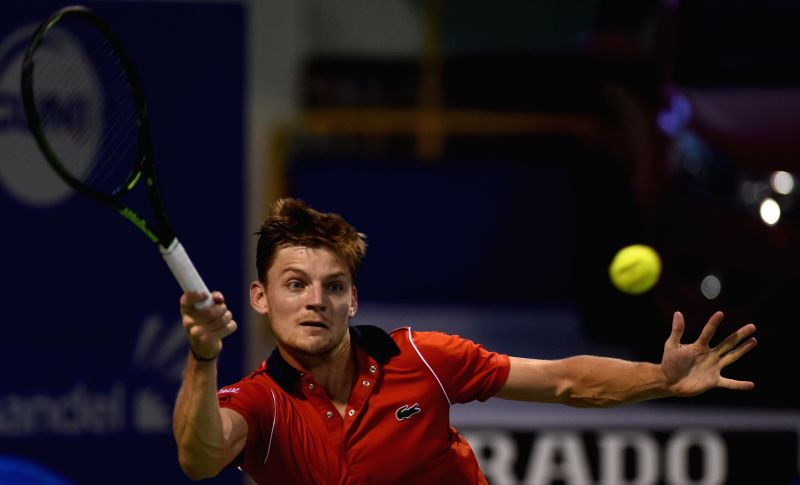 Belgian tennis player David Goffin in action against Lithuanian player Ricardas Berankis during the first round match of ATP Chennai Open 2015 in Chennai, on Jan 7, 2015.