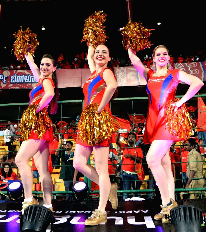 Cheer leaders perform during an IPL-2015 match between Royal Challengers Bangalore and Sunrisers Hyderabad at M Chinnaswamy Stadium, in Bengaluru, on April 13, 2015.