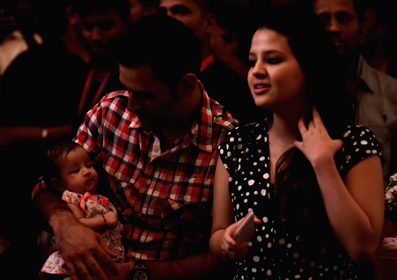 Chennai Super Kings captain MS Dhoni with his wife Sakshi and their daughter Ziva during a programme in Chennai on May 3, 2015. - MS Dhoni