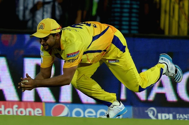 Chennai Super Kings (CSK) player Suresh Raina takes a diving catch during an IPL-2015 match between Chennai Super Kings (CSK) and Sunrisers Hyderabad (SRH) at MA Chidambaram Stadium, in ...