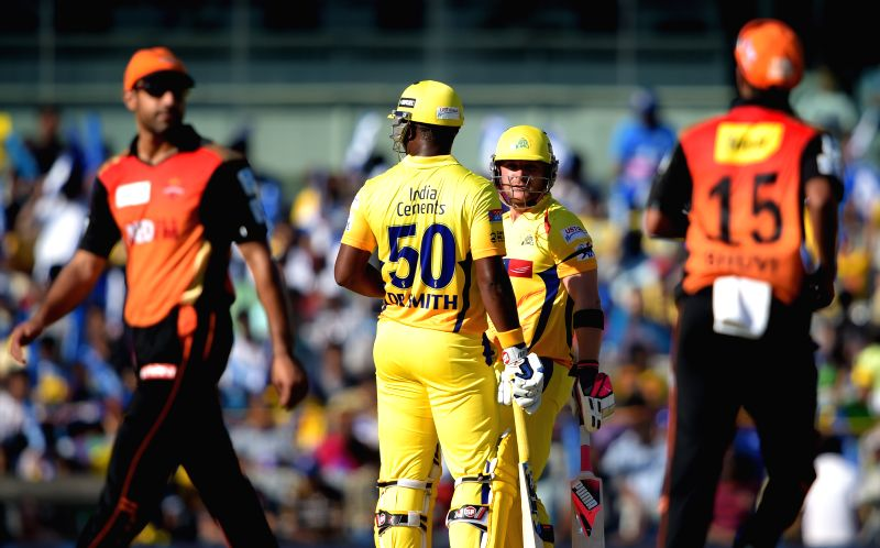 Chennai Super Kings (CSK) players Brendon McCullum and Dwayne Smith during an IPL-2015 match between Chennai Super Kings (CSK) and Sunrisers Hyderabad (SRH) at MA Chidambaram Stadium, in ...