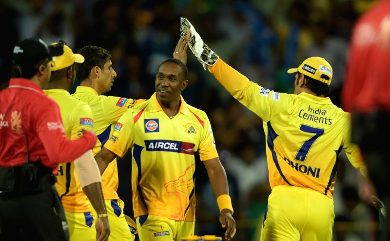 Chennai Super Kings players celebrate fall of a wicket during an IPL-2015 match between Chennai Super Kings and Delhi Daredevils at MA Chidambaram Stadium, in Chennai, on April 9, 2015.