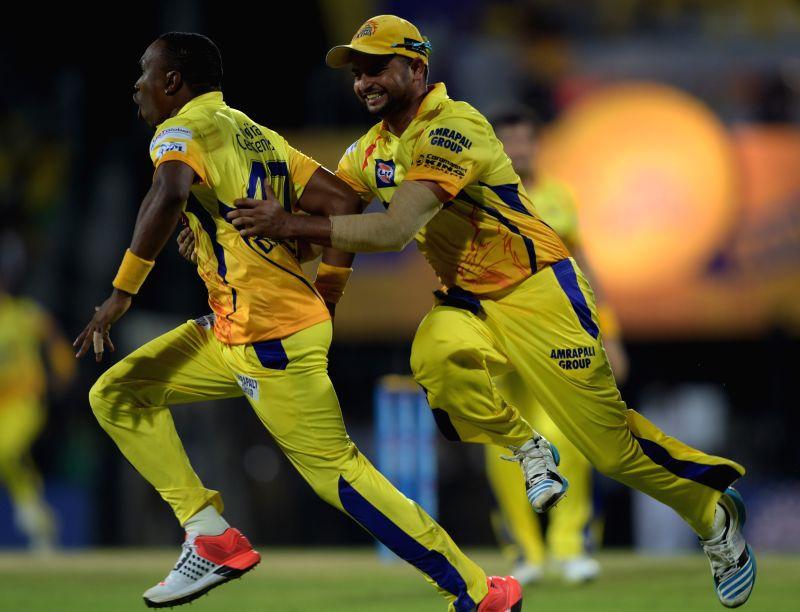 Chennai Super Kings players Dwayne Bravo and Suresh Raina celebrate fall of a wicket during an IPL - 2015 match between Chennai Super Kings and Kolkata Knight Riders at MA Chidambaram ...