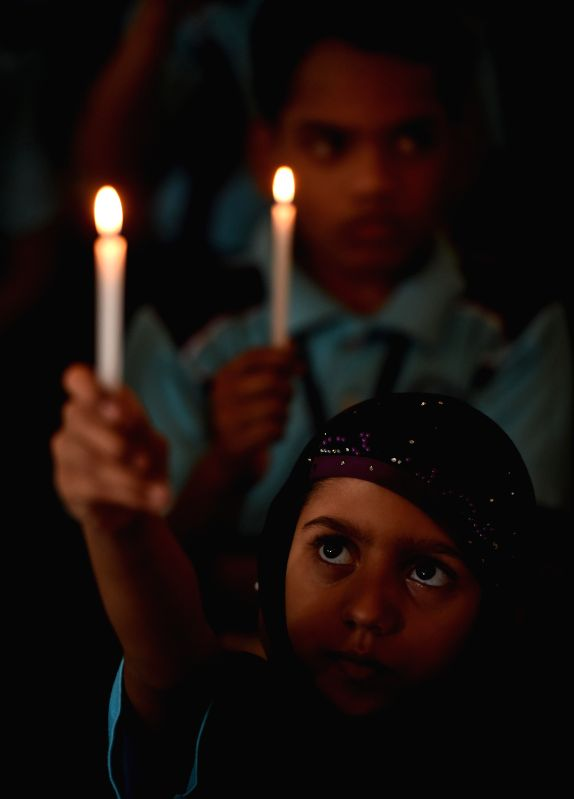 Children participate in a candle light vigil to protest against Tuesday's attack on the Army Public School in Peshawar, Pakistan, that claimed 104 lives mostly those of children, in Chennai,
