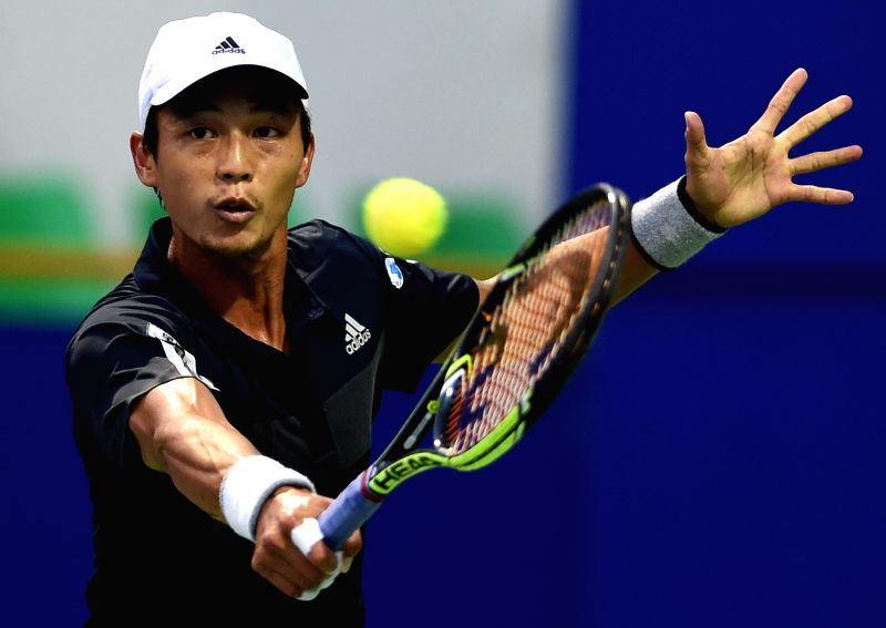 Chinese player Lu Yen-hsun in action against Spanish player Roberto Bautista Agut during the quarter-final match of ATP Chennai Open 2015 in Chennai on Jan 9, 2015.
