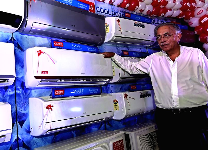 CMD Gulu Mirchandani of MIRC Electronics, manufacturers of ONIDA brand of electronic products, poses for photograph after the launch of the new range of air-conditioners in Chennai on Jan. .