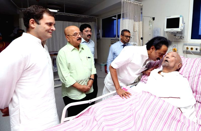 :Chennai: Congress President Rahul Gandhi meets DMK President M. Karunanidhi who is being treated at Kauvery Hospital in Chennai on July 31, 2018. Also seen DMK Working President M.K. Stalin. ...