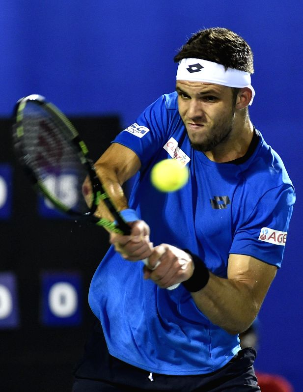 Czech Republican player Jiri Vesely in action against India`s player Vijay Sundar Prashanth during the first round of men`s singles match at ATP Chennai Open 2015 in Chennai on Jan. 6, 2014.