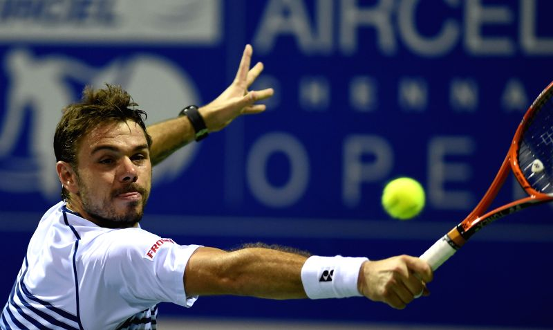 Defending tennis champion Stanislas Wawrinka of Switzerland in action against Gilles Muller of Luxembourg during the quarter-final match of ATP Chennai Open 2015 in Chennai on Jan 9, 2015.