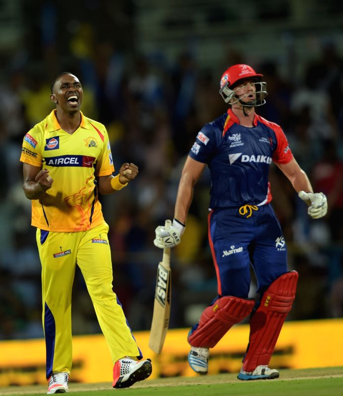 Delhi Daredevils batsman Albie Morkel and Chennai Super Kings player Dwayne Bravo during an IPL-2015 match between Chennai Super Kings and Delhi Daredevils at MA Chidambaram Stadium, in ... - Albie Morkel