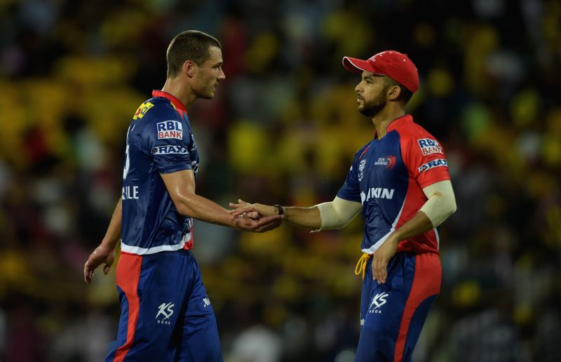: Delhi Daredevils players Nathan Coulter-Nile and and JP Duminy during an IPL-2015 match between Chennai Super Kings and Delhi Daredevils at MA Chidambaram Stadium, in Chennai, on April 9, ...