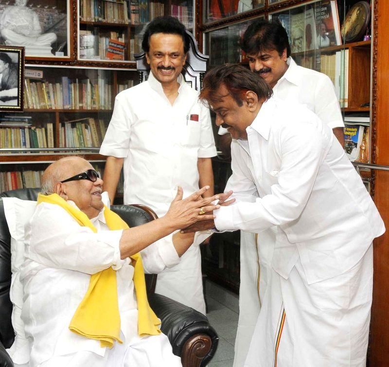 DMDK chief Vijaykanth during a meeting with DMK president M. Karunanidhi and DMK treasurer M K Stalin in Chennai, on April 26, 2015.