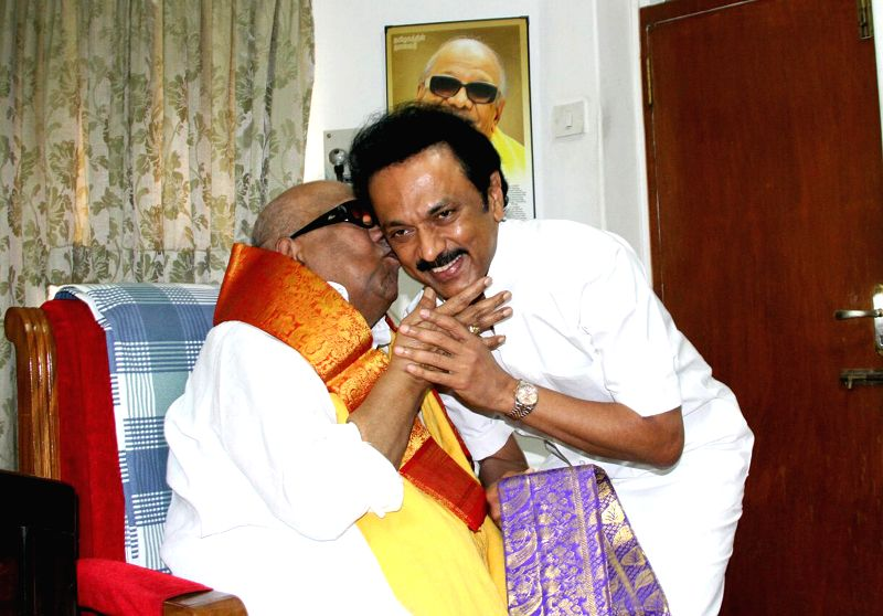 DMK chief M Karunanidhi blesses his son and party treasurer M K Stalin on his birthday in Chennai, on Feb 28, 2015.