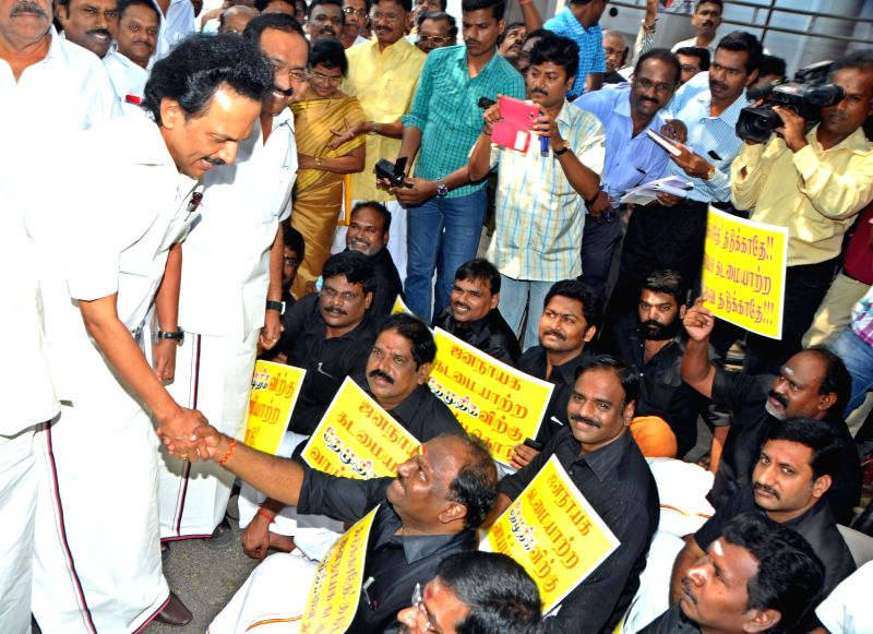 DMK treasurer MK Stalin shakes hands with the suspended legislators of DMDK in Chennai, on March 25, 2015.