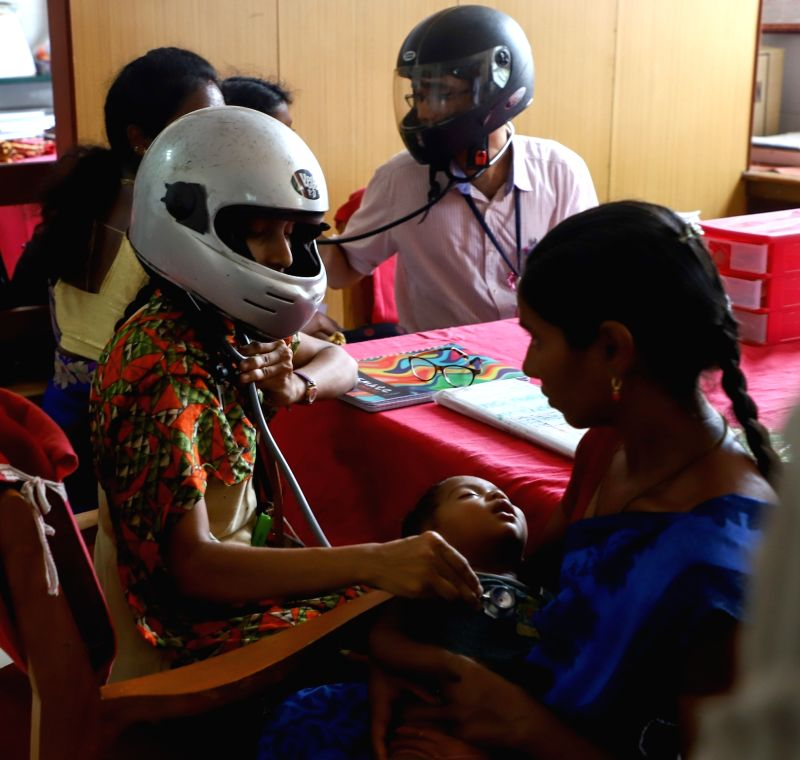 Chennai: Doctors at work seen wearing helmets while on duty to support the junior doctors' stir of NRS Medical College, Kolkata, who were attacked on June 10; in Chennai on June 17, 2019. (Photo: IANS)
