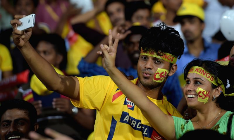 Fans cheer during an IPL-2015 match between Chennai Super Kings (CSK) and Delhi Daredevils (DD) at MA Chidambaram Stadium, in Chennai, on April 9, 2015.