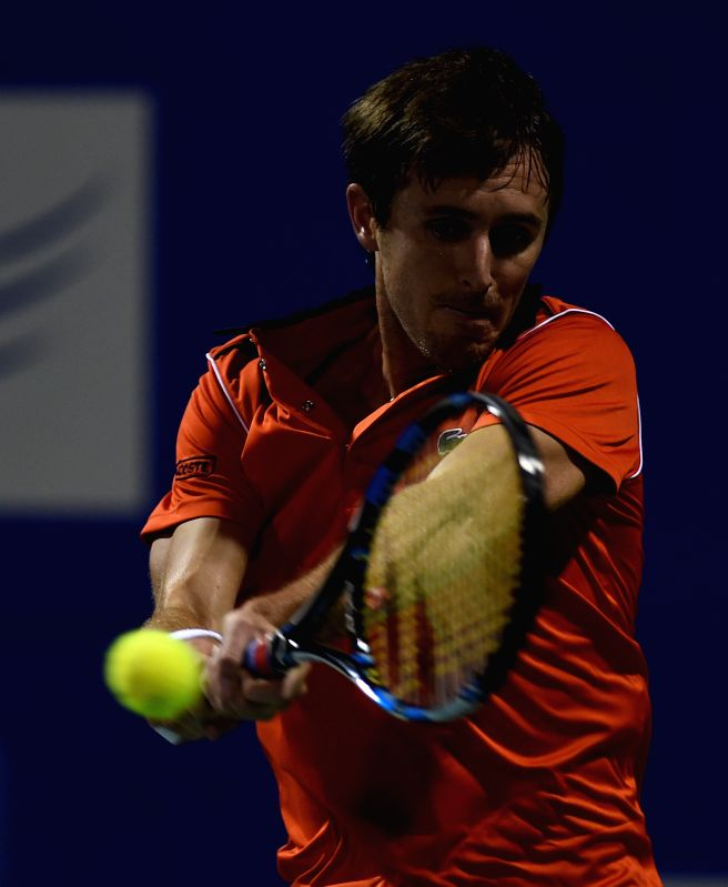 French tennis player Edouard Roger-Vasselin in action against Luxembourgian player Gilles Muller during the first round of ATP Chennai Open 2015 in Chennai on Jan. 5, 2014.
