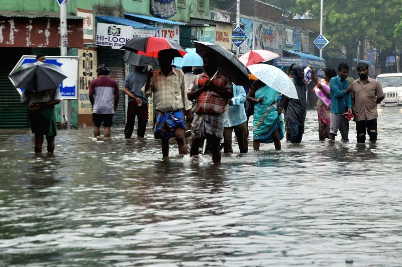 : Chennai: Heavy rains cause waterlogging and flooding of streets in Chennai on Nov. 16, 2015. (Photo: IANS).