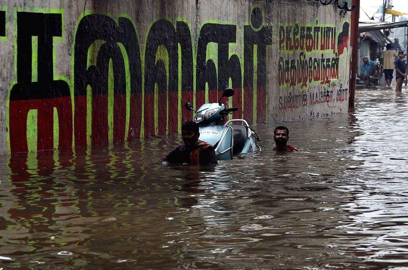 :Chennai: Heavy rains cause waterlogging and flooding of streets in Chennai on Nov. 16, 2015. (Photo: IANS).