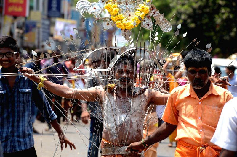 Hindu devotees participate in a procession organised on Panguni Uthiram in Chennai, on April 3, 2015.