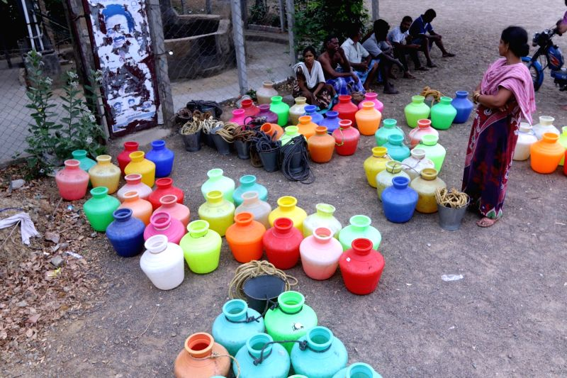 Chennai: Locals wait to collect water from a community well amid ongoing water crisis in Chennai, on July 2, 2019. (Photo: IANS)