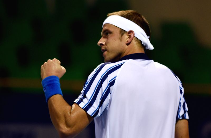 Luxembourgian tennis player Gilles Muller in action against France`s Edouard Roger-Vasselin during the first round of ATP Chennai Open 2015 in Chennai on Jan. 5, 2014.