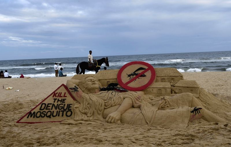 Noted sand artist Sudarshan Pattanaik creates a sand sculpture on Dengue awareness  in Chennai on Dec 15, 2014.