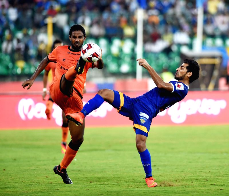 Players in action during an ISL match between Delhi Dynamos FC and Chennaiyin FC in Chennai, on Dec 9, 2014.