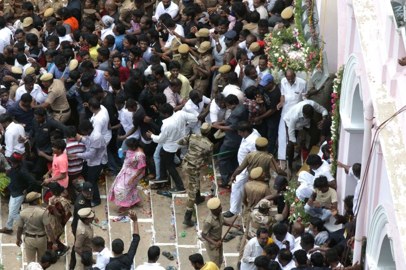 : Chennai: Police personnel resort to baton-charge to disperse a large crowd of supporters forcefully trying to enter Rajaji Hall where the body of the late DMK President M. Karunanidhi is lying in ...