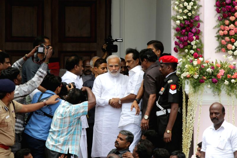 : Chennai: Prime Minister Narendra Modi comforts M.K. Stalin as he pays last respect to DMK patriarch M. Karunanidhi at Rajaji Hall in Chennai on Aug 8, 2018. (Photo: IANS).