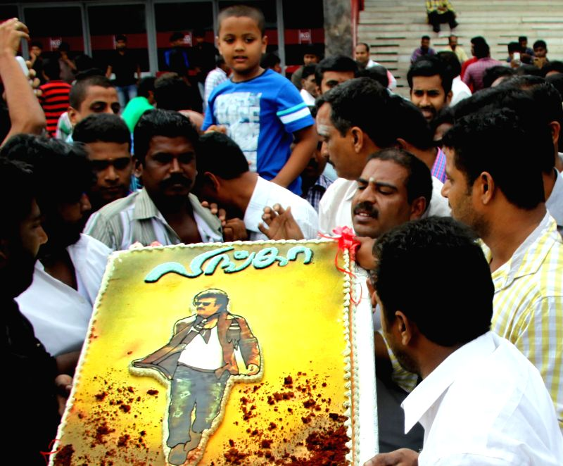 Rajinikanth fans throng a theatre to watch his newly launched film `Lingaa' on his birthday in Chennai on Dec 12, 2014.