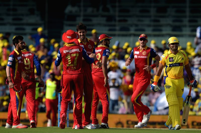 Royal Challengers Bangalore celebrate fall of a wicket during an IPL 2015 match between Chennai Super Kings and Royal Challengers Bangalore at M. A. Chidambaram Stadium in Chennai on May 4, ...