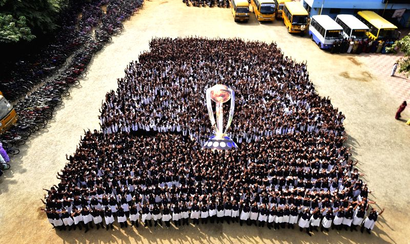 School students hold a replica of ICC World Cup ahead of ICC World Cup 2015 in Chennai on Feb 12, 2015.
