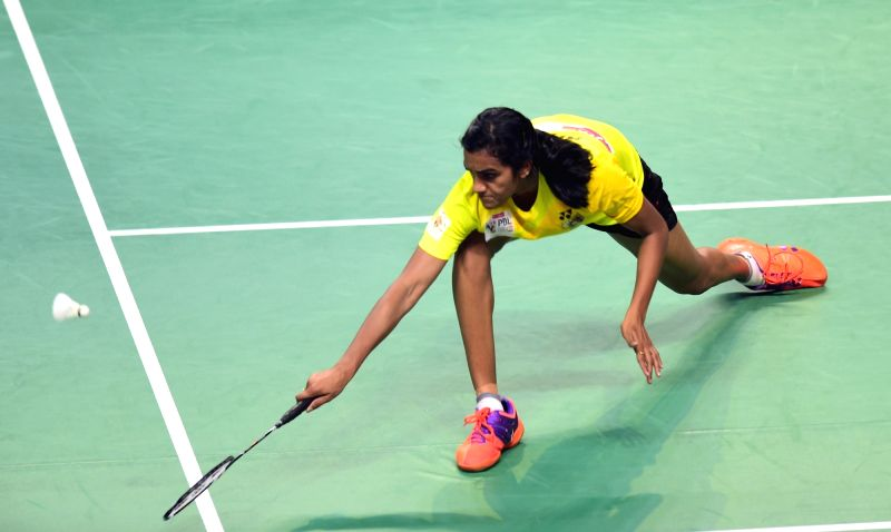 Chennai Smashers' P V Sindhu in action against  Awadhe Warriors'  Rituparna Das during a Premier Badminton League 2017 match at Koramangala Indoor Stadium in Bengaluru, on Jan 11, 2017.
