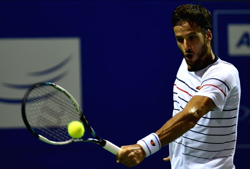 Spanish tennis player Feliciano Lopez in action against Slovenian player Brit Aljaz Bedene during an ATP Chennai Open 2015 match in Chennai on Jan 8, 2015.
